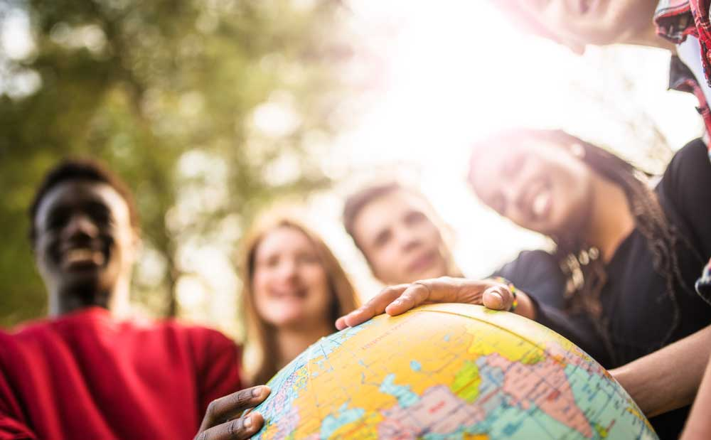 Photo of students with a globe